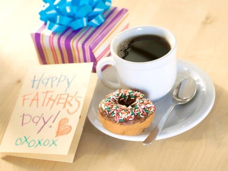 card for dad, cup of coffee, doughtnut with sprinkes, and a present