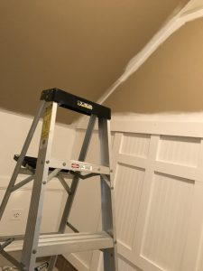 Using a ladder for the high ceilings