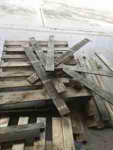 wood pallet being taken apart for crafting