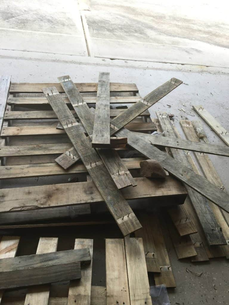 wood pallet being taken apart for crafting