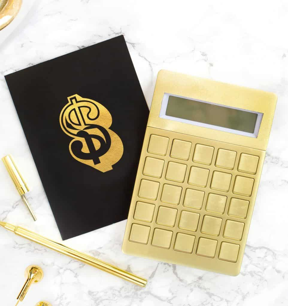 how to save money as SAHM with calculator and checkbook
