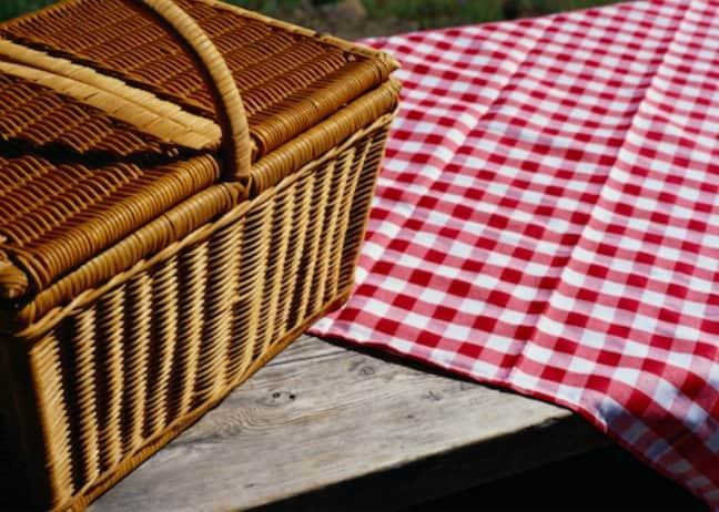 picnic basket on table outside