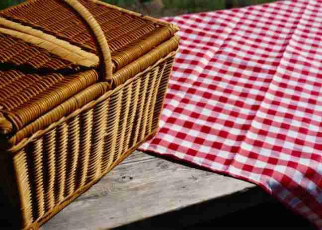 picnic basket on table outside