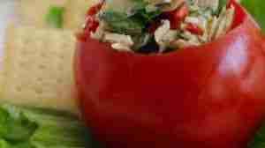 Tuna and artichoke salad in a tomato for lunch