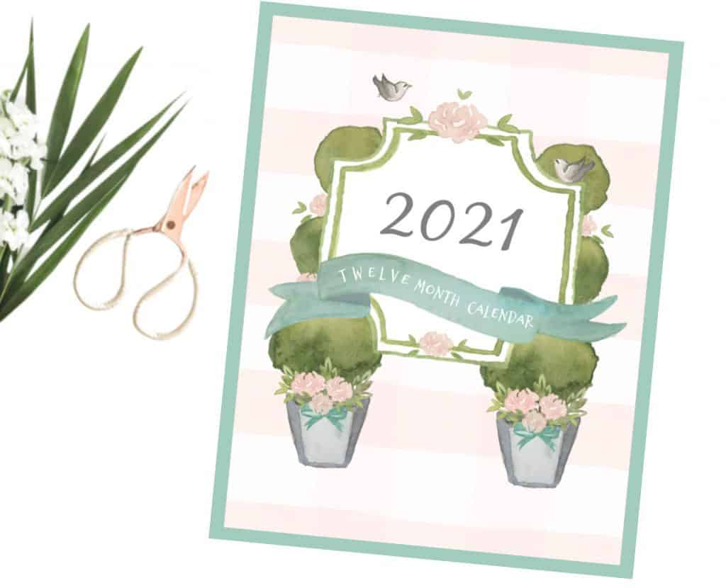 2021 Calendar cover that is pink with flowers.