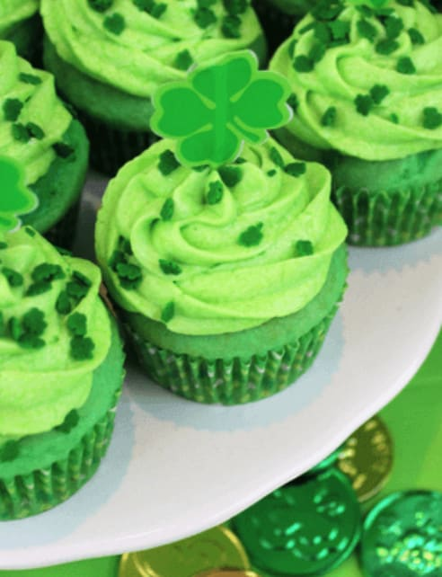 Green Keto St. Patrick's Day cupcakes on a white plate.