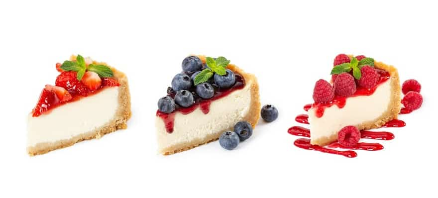 3 pieces of cheesecake on a white counter.