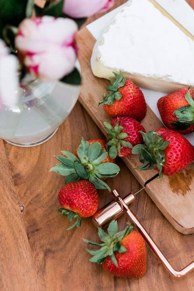 women snacking on strawberries