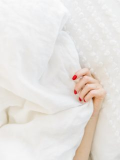 woman not feeling well and in bed