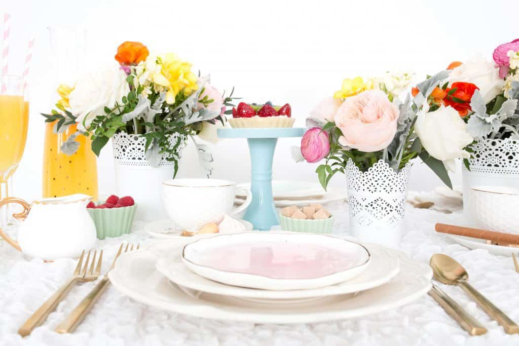 Easter table setting with flowers.