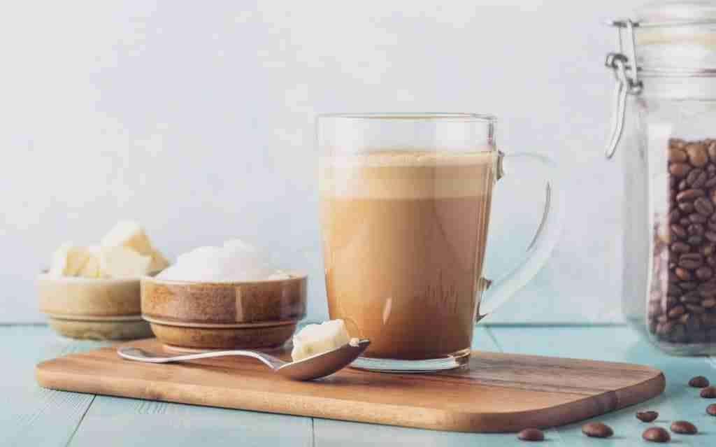 Breakfast keto butter coffee recipe drink on a cutting board.