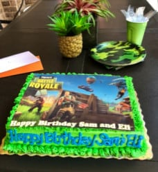 Fortnite birthday cake, plates, and cups.