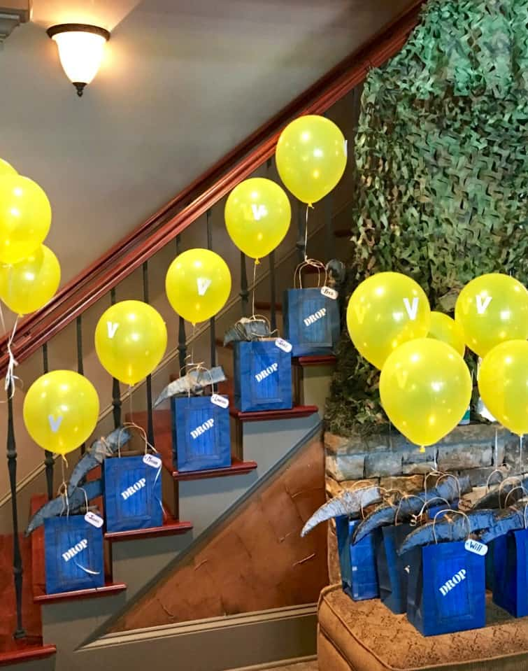 Fortnite party supplies gift bags and drop balloons.